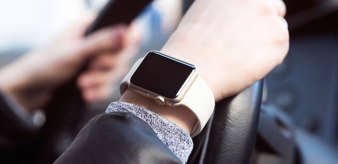 Apple watch on someone's wrist as they are driving