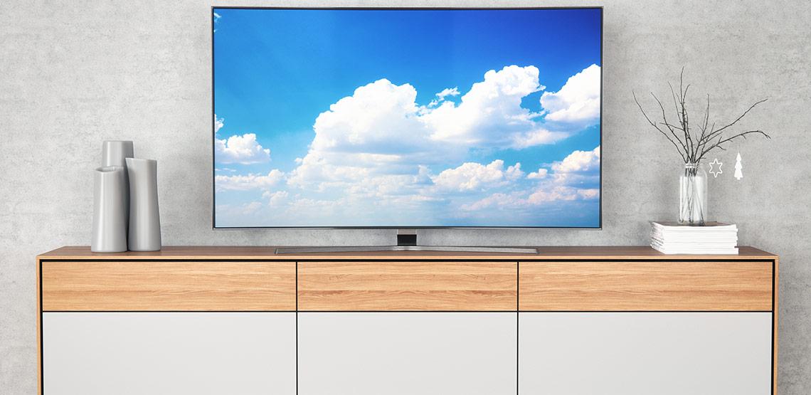 Flatscreen TV on modern TV stand