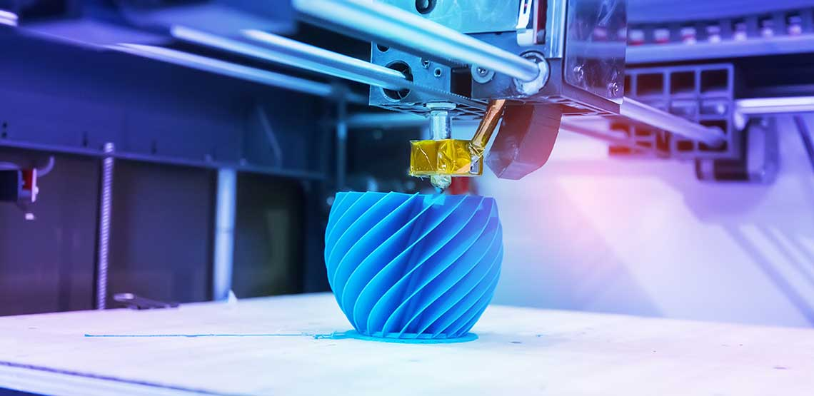 A blue object being created with a 3D printer