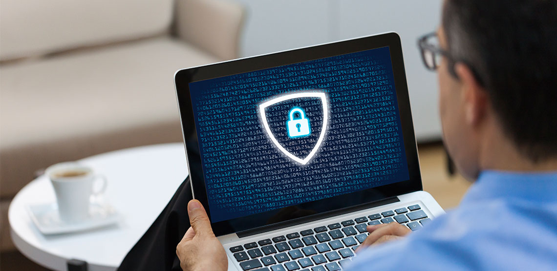 Man with laptop with a lock on the screen