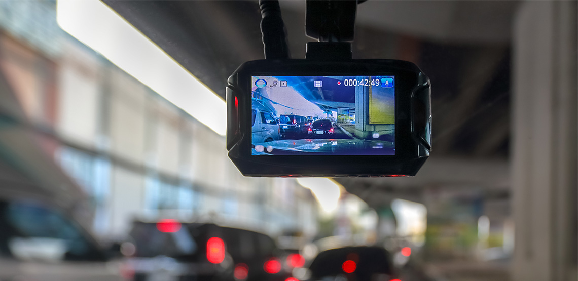 Camera mounted on inside of windshielde of a car